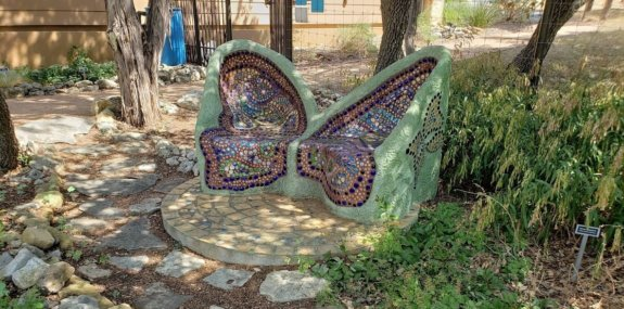 butterfly mosaic bench in garden